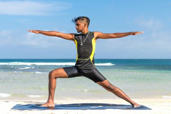 man-doing-yoga-at-the-beach